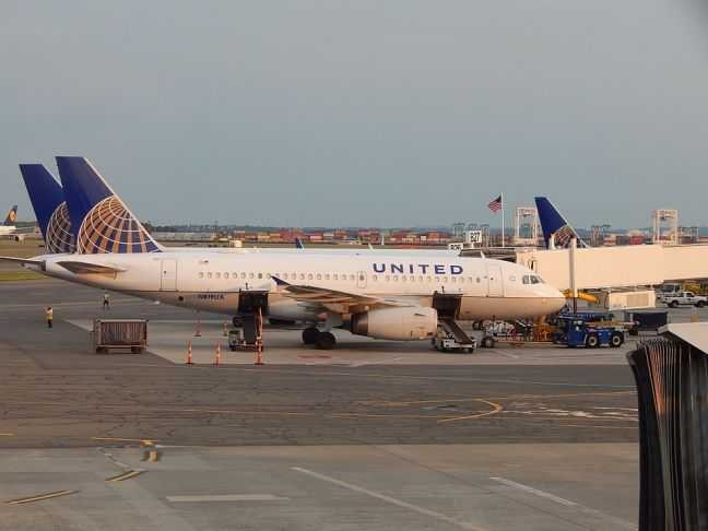 A United Airlines aircraft on the tarmac at an airport.