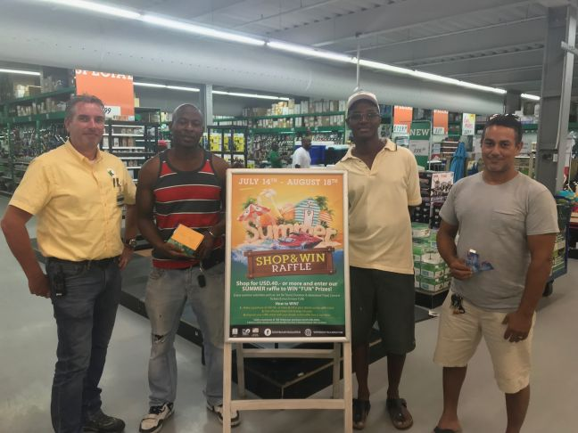 (L-R )Store Manager, Nico Boersma and winners Melchoir Hughes, Vincent Ellis and Herbert Libier.