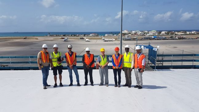 (center) COO, Michel Hyman with the SXM Airport Team (right) and the Bellast Nedam Team (left).