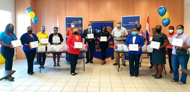 Members of the Rotary Club of St. Martin Sunset officially handing over donated tablets to the various public school managers in the presence of the Minister of Education, Culture, Youth and Sport, Drs. Rodolphe Samuel.
