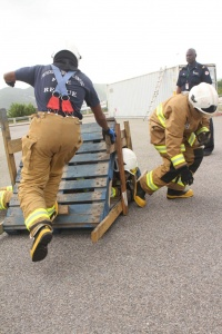 SXM Airport firemen during an obstacle course routine for Firemen's Week 2014. (SXM photo)