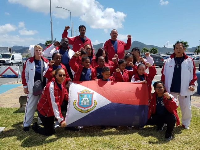 King Yen Taekwondo School Grand Master, Theo Liu, (Right) with the St. Maarten delegation of athletes shortly before leaving the island for Puerto Rico, Friday.
