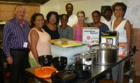 Island Gems members with Foundation Director Piet Lucas, Information and Prevention Coordinator Donette McRae, Executive Assistant Tess Blom, Cook Cynthia Arrindell, assistant cooks Bryan Hodge, and Immanuel Peters in the foundation's kitchen. (photo contributed)