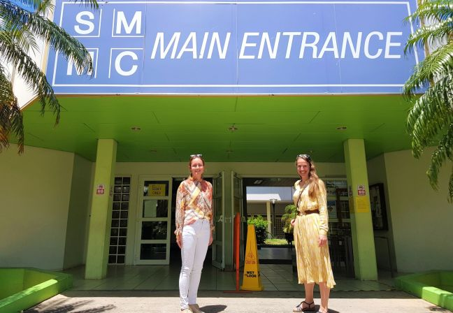 Dr. Kim Verschueren (left) and Dr. Katja Andeweg pose, while maintaining appropriate social distance, in front of SMMC's main entrance.