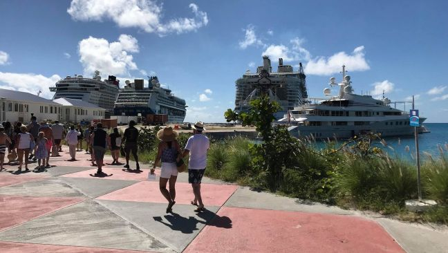 Cruise ships along with a Mega Yacht in port while cruise passengers return from a fun-filled day enjoying the 'Friendly Island.'