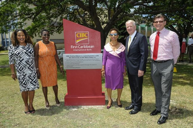 From Left Debra King Director of Corporate Communications at CIBC FirstCaribbean, Lynda Goodridge Director of the CIBC Comtrust Foundation, Professor Barriteau, Gary Brown and Neil Brennan Managing Director, Human Resources at CIBC FirstCaribbean stand by the newly unveiled Plaque.