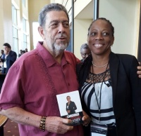 Dr. Ralph Gonsalves (L), Prime Minister of St. Vincent and The Grenadines, receives copy of Language, Culture, and Identity in St. Martinfrom its author, Dr. Rhoda Arrindell—following informal meeting at the conference hall, Hyatt Regency, Trinidad and Tobago (5.6.15).  (© RA photo)
