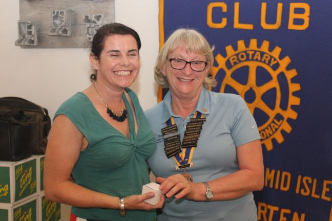 Honey Sheriden (left) received a token of appreciation from President Denise Antrobus (right).