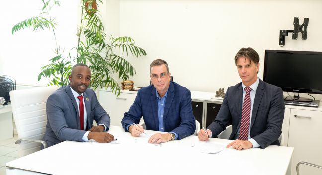 L to R: Minister Ardwell Irion, SZV Director Glen Carty, and SMMC's Chief Financial Officer Dr. Marco Meuleman during the signing.
