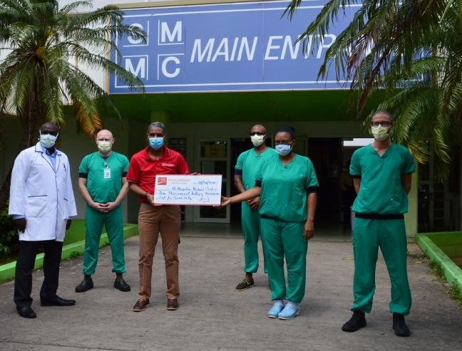 CIBC FirstCaribbean Country Manager, Garth Sherwood with SMMC Medical Director, Dr. Felix Holiday and members of staff.