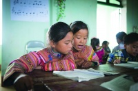 Two 5th graders do their assignment during class at PS La Pan Tan in Viet Nam. Photo: Tuan Nguyen/EFA Report UNESCO