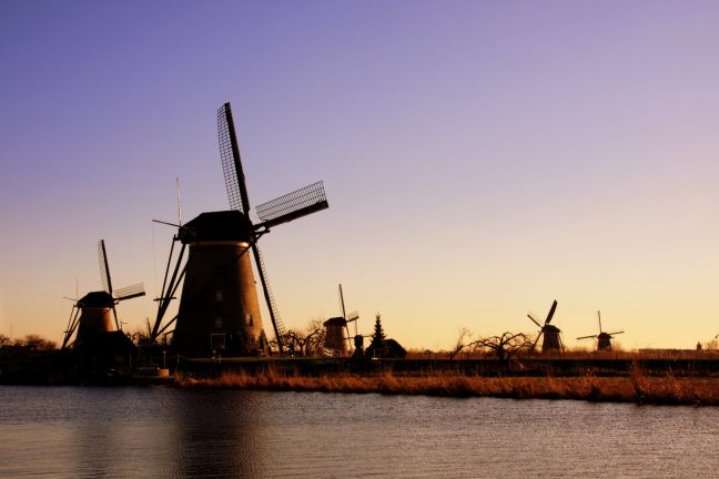 Sunset at Kinderdijk. Photo: Porcelaingirl via Wikimedia Commons