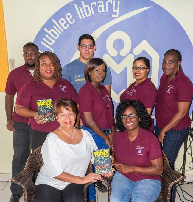 (L-R): Library Interim Director, Irmin Hughes, author Yolanda  Croes, and staff of the Philipsburg Jubilee Library.