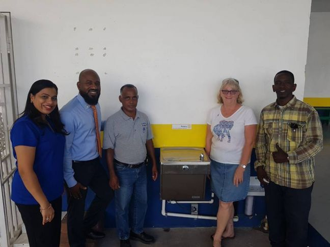 Mrs Shaina Fernandes, Rotarians Quincy Lont and Tony da Cunha, President Denise Antrobus and plumber Mr. Raymond Alexander.