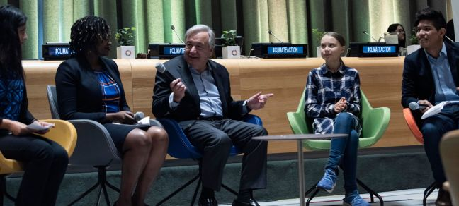 UN Photo/Kim Haughton Secretary-General António Guterres (centre) and Greta Thunberg (second from right), Youth Climate Activist, at the opening of the UN Youth Climate Summit.