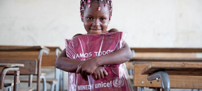 UNICEF/James Oatway Six-year-old girl in Beira receives her education pack as part of UNICEF's ramped-up response to children and families in Mozambique affected by Cylcone Idai, April 2019.