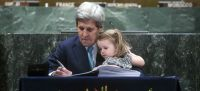 UN Photo/Amanda Voisard Former United States Secretary of State John Kerry, accompanied by his grand-daughter, signs the Paris Agreement at UN headquarters in April 2016.