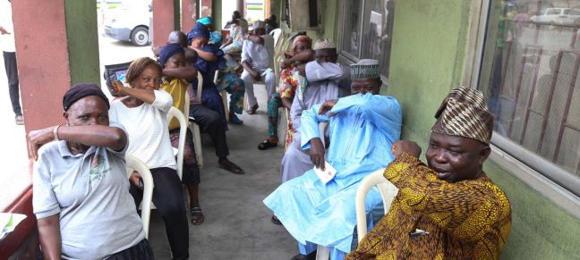 © UNICEF/Ojo People living in Lagos State in Nigeria, simulate sneezing into their elbows during a coronavirus prevention campaign.