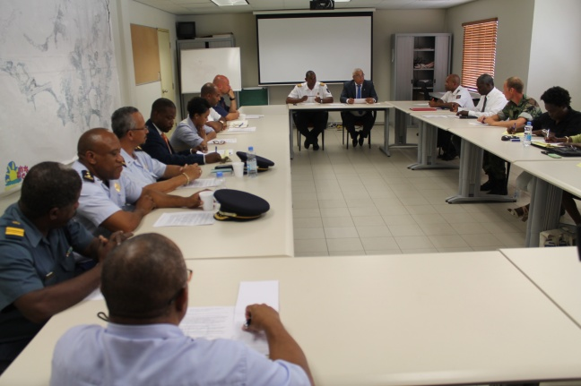 Seated at the head of the table is National Disaster Coordinator/Fire Chief Clive Richardson (left) and Prime Minister Hon. Marcel Gumbs (right) in discussion with coordinators from the 10 ESFs. DCOMM Photo