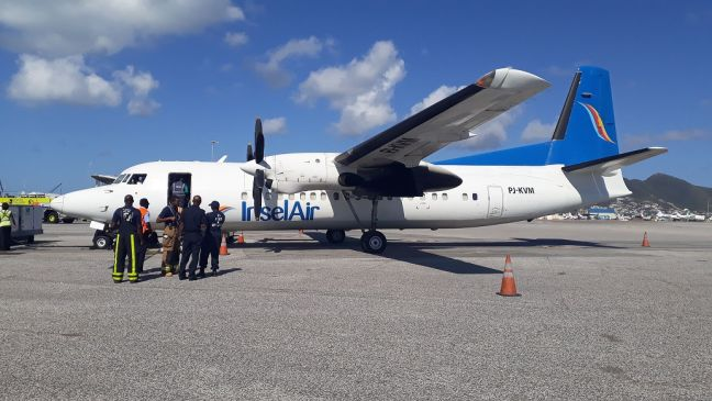 SXM Airport, the Insel Air Fokker 50 aircraft being inspected by fire officials after the aircraft landed. (Photo's contributed)
