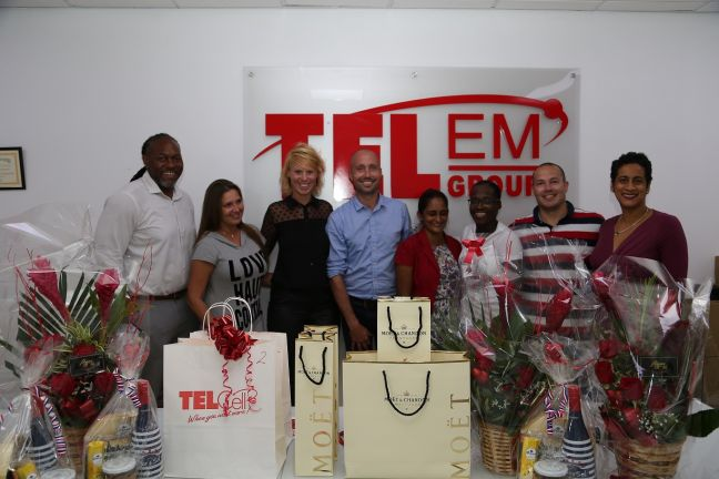 "Winners and sponsors of TelCell's ""Weekend of Love"" SMS promotion during a presentation ceremony at the TelEm Group main building Wednesday – Valentine's Day."