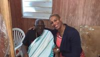 "Member of Parliament Elect Grisha Heyliger-Marten (right) during a visit with Hermogenes Polonia Raap who will be 101-years-old in April this year. Hermogenes better known as ""Rap"" has lived on St. Maarten for over 40 years and has never been acknowledged even after becoming a centenarian."