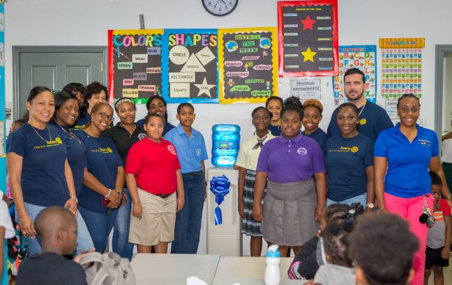Members of the Rotary Club of St. Martin Sunset with students and staff of the Excellence Learning Academy during the presentation of the water cooler.