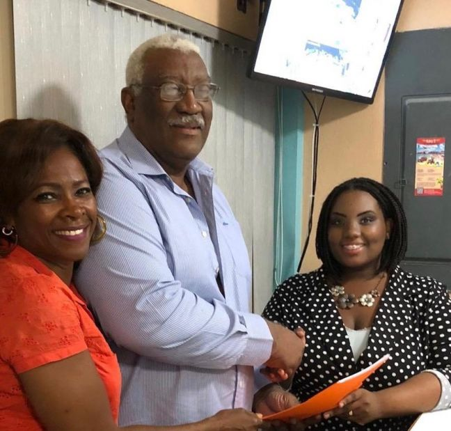L to R: PPA leader Gracita R. Arrindell: center: Founder and past party President Mr. Don R Hughes; new Party President Mrs. Leandra Cijntje-Leslie.