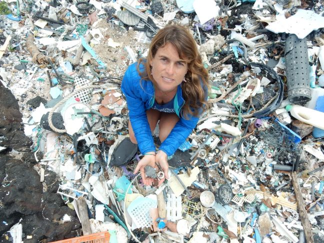 Dr. Sarah-Jeanne Royer holding micro plastics at Kamilo Point on Big Island Hawaii on February 14th 2018. The photo can be credited to IPRC.