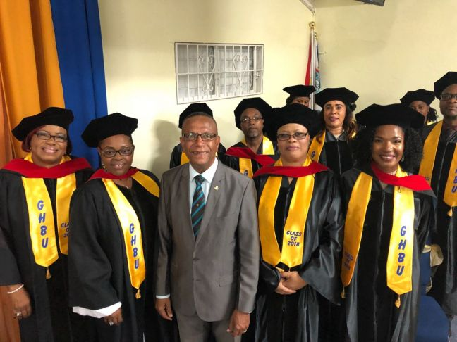 The former Minister of Education The Honourable Wycliffe Smith with GHBU graduates of 2018