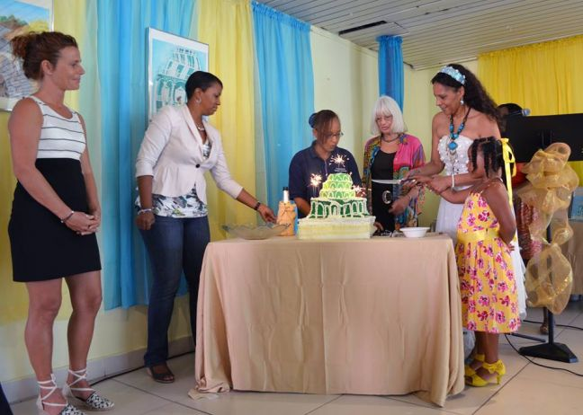 Extreme left, Tess Verheij (illustrator) and Loekie Morales (right) cutting the Magical Wedding Cake in the Philipsburg Jubilee Library, during the book launch in 2012. (Photo contributed)