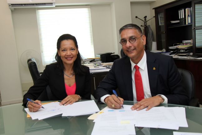 L to R: TelEm Chief Financial Officer Helma Etnel and Minister of Finance Hon. Perry Geerlings.
