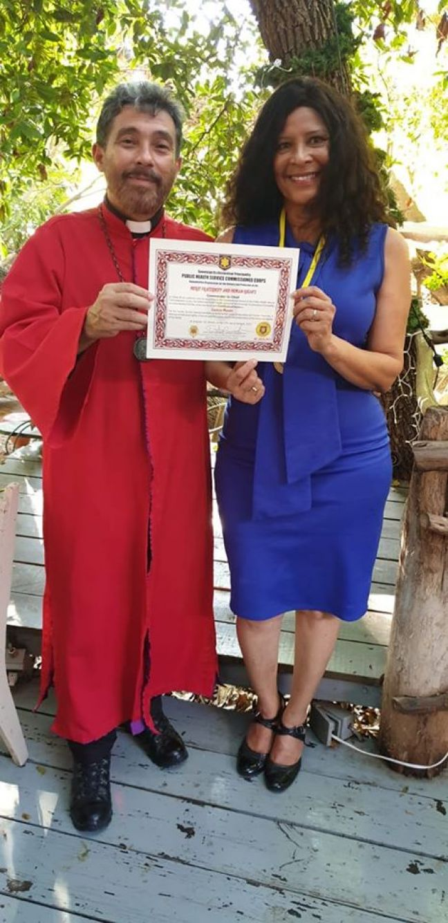Morales receiving the certificate of Honor and plaque from Adao Pereira, Major Archbishop of the Holy Major Archiepiscopal See from Brazil.