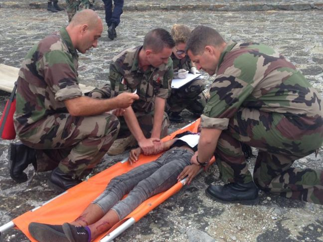 Members of the Dutch military providing first aid to an injured person during the HUREX simulated exercise. (Photo Dutch Military)