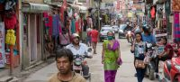 World Bank/Peter Kapuscinski People walk down a street of shops in Kathmandu, Nepal. (file)
