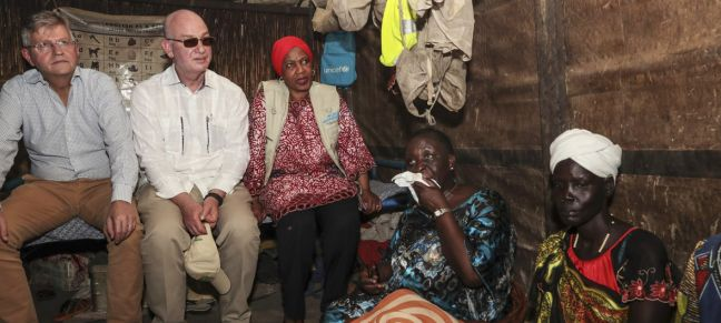 UNMISS/Isaac Billy A high-level delegation from the United Nations and African Union meets Nyamile Malual Jiech (far right) who walked with her children through violent clashes to reach the safety of the United Nations protection site in Bentiu in the north of South Sudan.