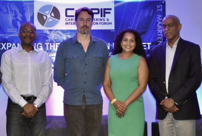 From left, Bevil Wooding, organizer of the Caribbean Peering and Interconnection Forum (CarPIF); Bill Woodcock, Executive Director, Packet Clearing House; Rhea Yaw Ching, Executive Director, Covela Foundation; and Albert Daniels, Caribbean Stakeholder Engagement Senior Manager, ICANN, at the third annual CarPIF meeting, in Phillipsburg, Sint Maarten, July 6, 2017. Photo courtesy: CarPIF