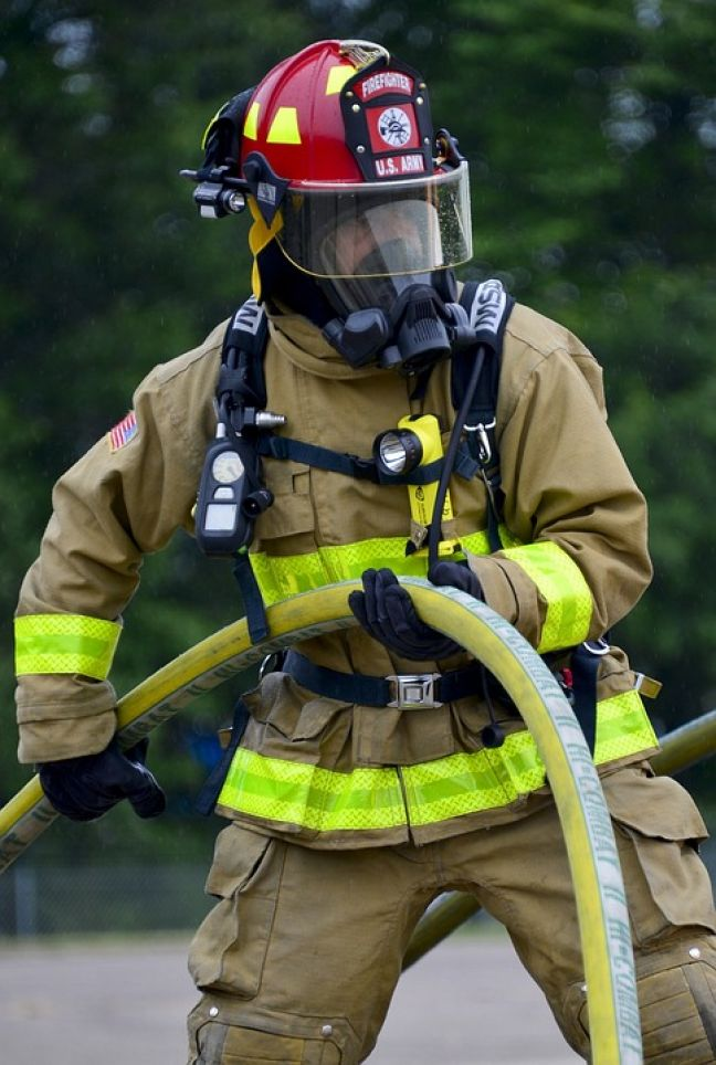 A fire fighter wearing a breathing apparatus.