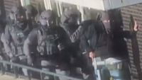 A still from the police footage of one raid when the seven men were arrested.
