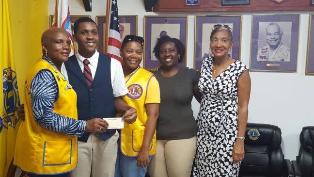 From left Lion Oralie Boirard-Lions Club Secretary, Jeremiah David, Lion Jennifer Johnson - Lions Club Board Member, Amewsika Jones - Jeremiah's Mother and Claudette Forsythe Labega -Director of CBA
