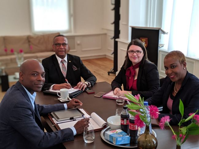 Deputy Minister Plenipotentiary Michael Somersall (left) and staff welcomed Minister ECYS Wycliffe Smith (second left) to the Sint Maarten House in the Hague.