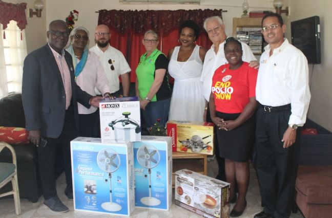 In photo from left to right: Rotary District Governor Dr. Patrick Adizua and his wife Dr. Leslie Adizua; Secretary Aernout Kraaijeveld, President Denise Antrobus, Cassandra Richardson, Safe Haven Executive Director; foundation chair David Antrobus, Assistant Governor Marcella Henry, New Generations chair Jon Hart.