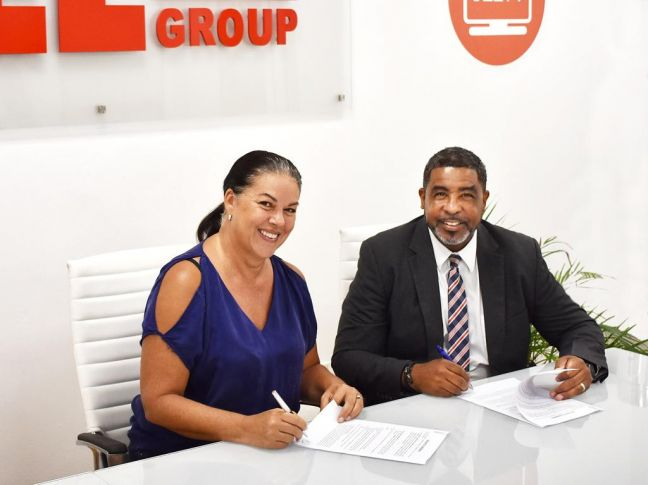 Rice Hill Gardens Development Managing Director Astrid Plantz and TelEm CEO Kendall Dupersoy sign the Fiber Optic Exclusivity Agreement.
