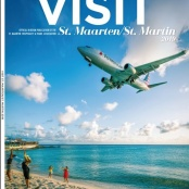Minister Johnson congratulates Hazel on Winning Front-page photo of VISIT Destination Promotional Magazine