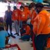 Nine students learn the basics of sail making