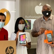 MP Ottley and others donate 63 electronic devices to students for online learning