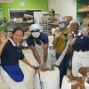 Tzu Chi distributes 16,394 loaves bread during lockdown