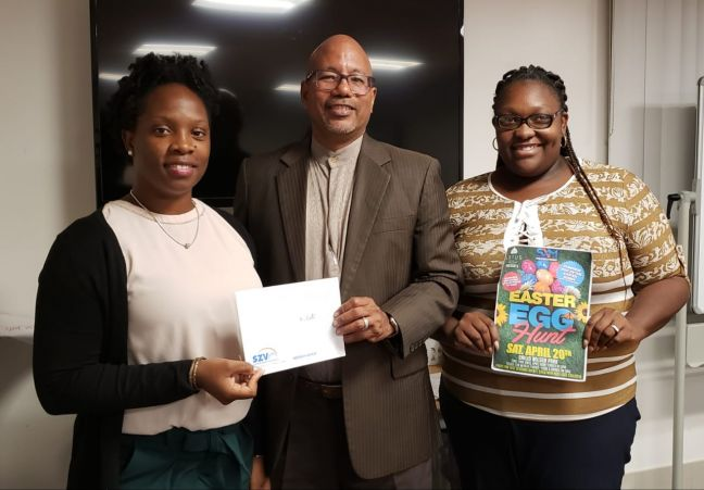 L-R: Department Manager of the Sister Basilia Center – Ms. Mimi Hodge, Unit Manager Operations Mr. Reginald Willemsberg and Medical clerk Mrs. Shantal Marsham- Etienne with donation of 10 tickets for clients to participate in Easter Egg Hunt.